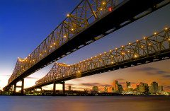 NEW ORLEANS mississippi river bridge and the skyline